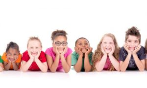 large group of children of different ages on white background