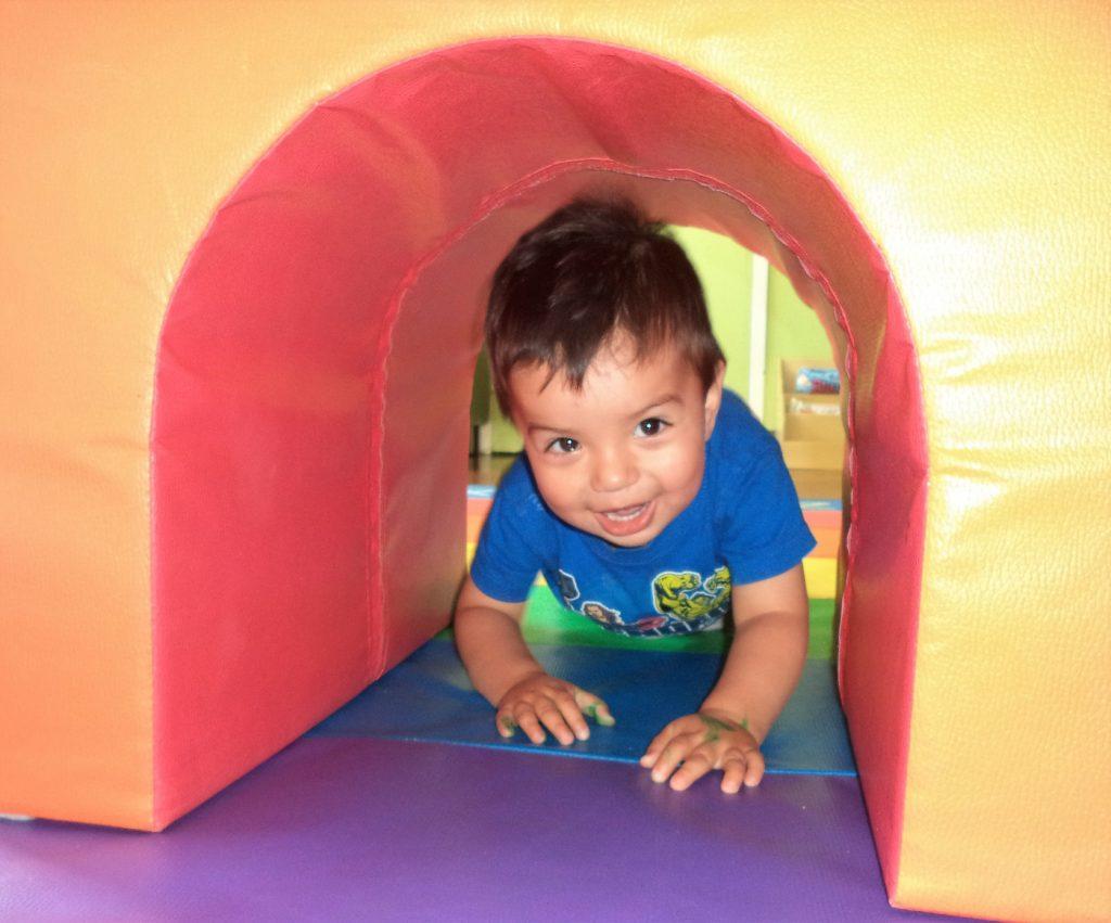 toddler crawling through tunnel